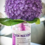 Flower-filled beakers at every table were customized with lab labels we created.